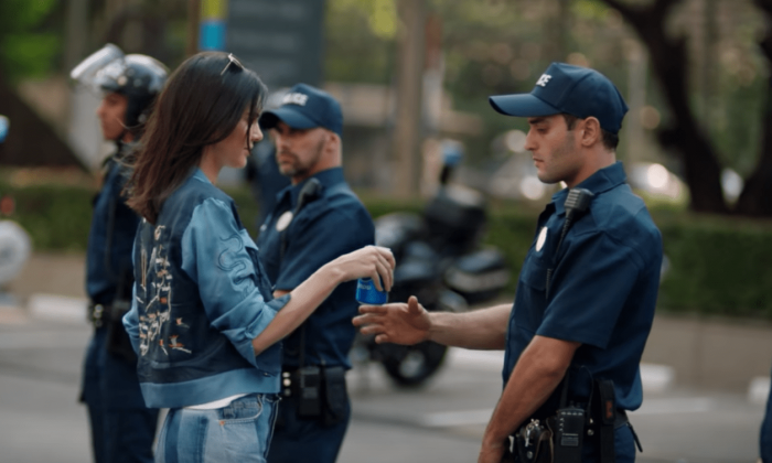 Kendall Jenner Gives Policeman a Pepsi